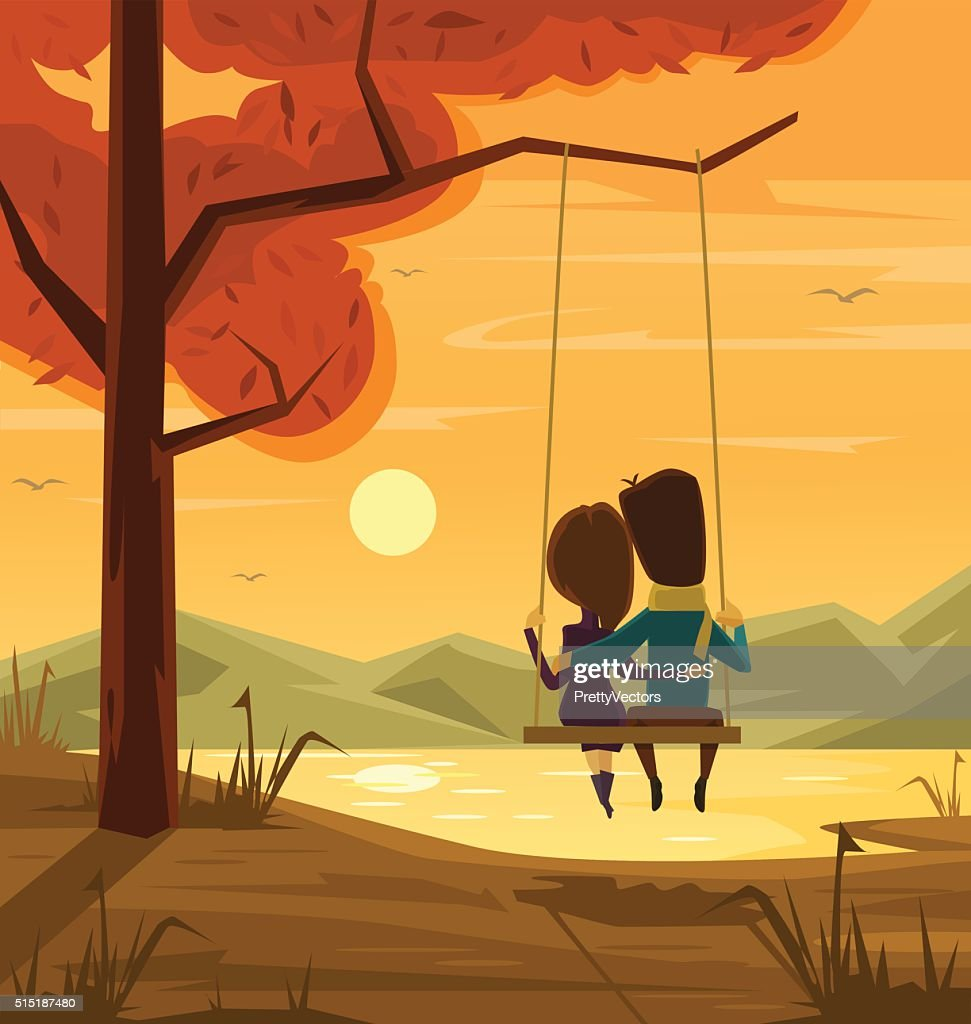 Two lovers sitting on swing at sunset