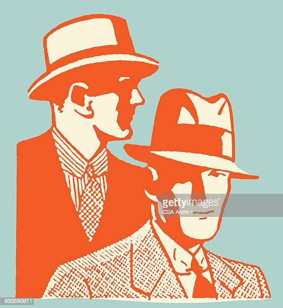 Two Men Wearing Hats