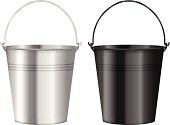 Two metal buckets in silver and black on a white background