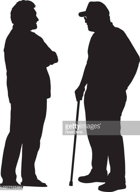 two older men talking silhouette - mature adult stock illustrations