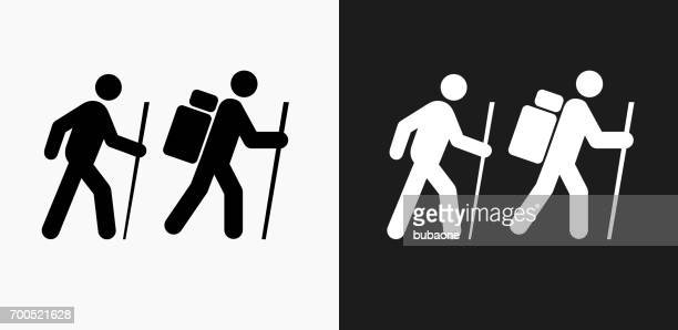 Two People Hiking Icon on Black and White Vector Backgrounds