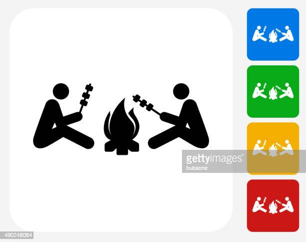 Two People Next to Campfire Icon Flat Graphic Design