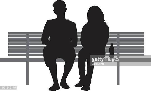 Two People Sitting on Bench