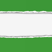 Two pieces of torn green color paper with ripped edges and white hole between them