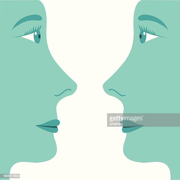 two profiled faces looking at each other - teenage girls stock illustrations
