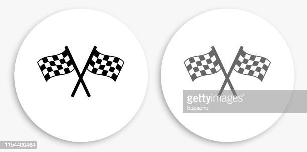 two racing flags black and white round icon - checkered flag stock illustrations