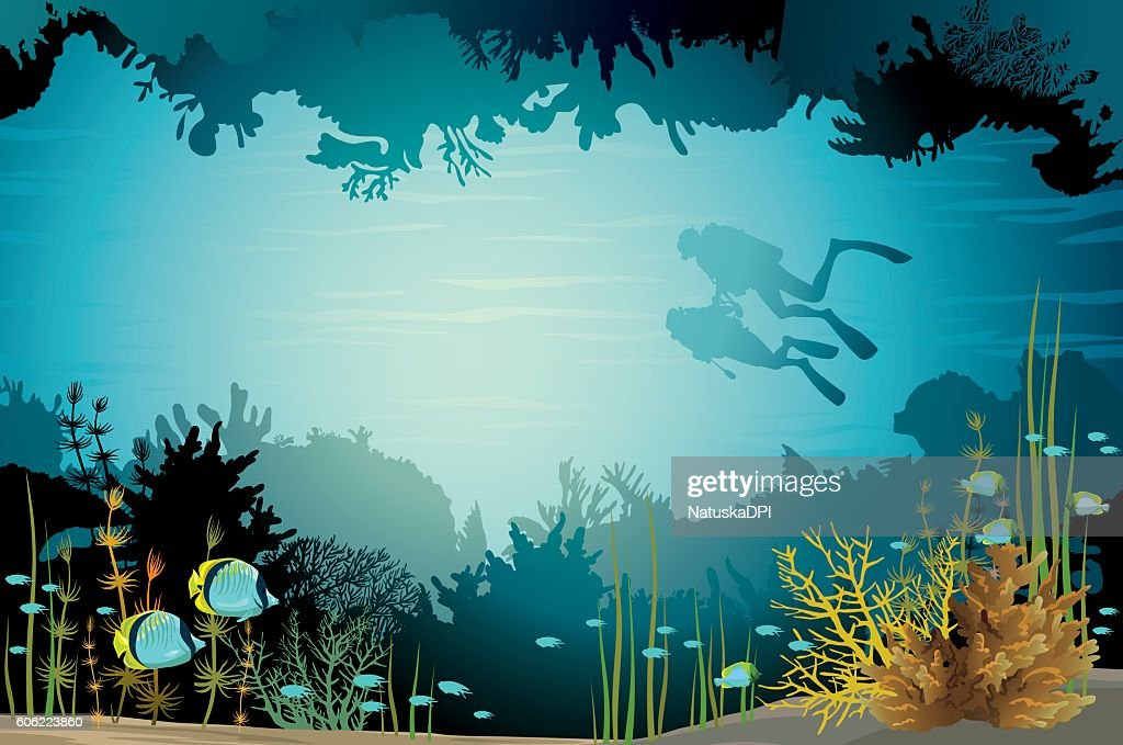 Two scuba divers and underwater cave with fish.