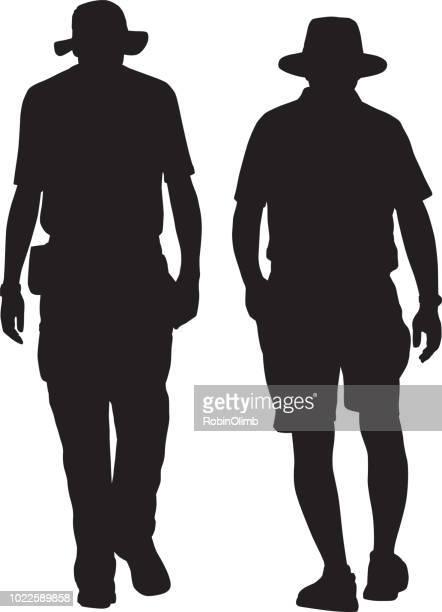 Twee Senior mannen lopen samen silhouet