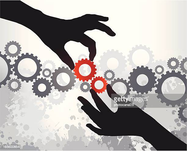 Two silhouetted hands putting red gears into a chain