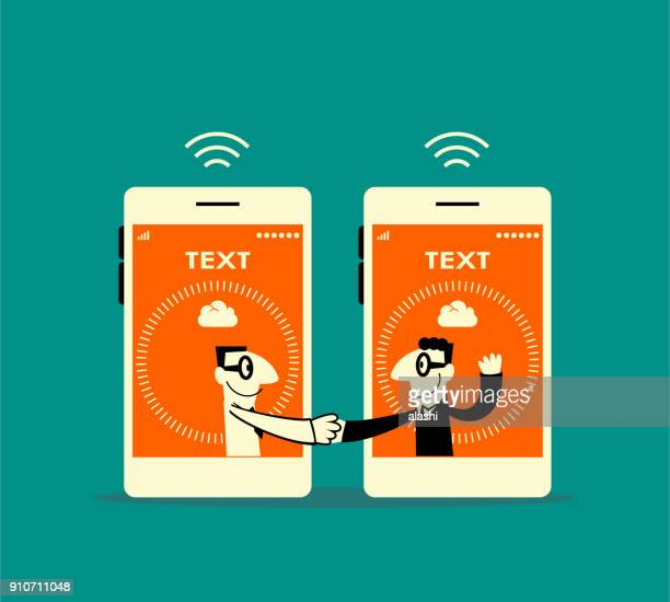 Two smiling businessmen inside of smart phone (mobile phone) meeting (greeting) with a handshake