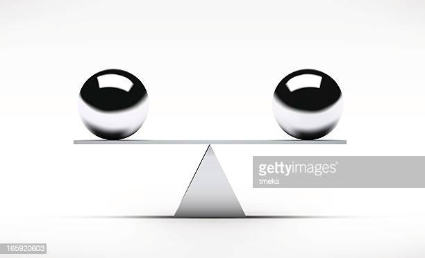 two spheres balancing on a rudimentary seesaw - balance stock illustrations