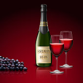 Two wineglass of champagne with bottle and grapes