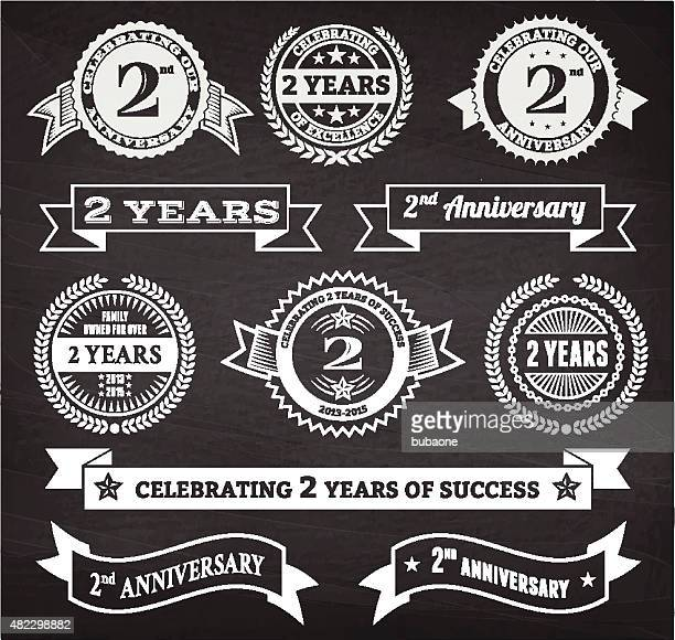 two year anniversary hand-drawn chalkboard royalty free vector background - number 2 stock illustrations