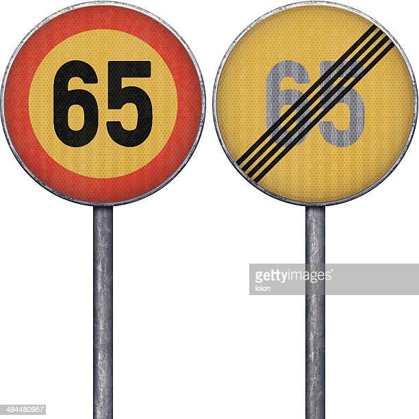 Two yellow and red maximum speed limit 65 road signs