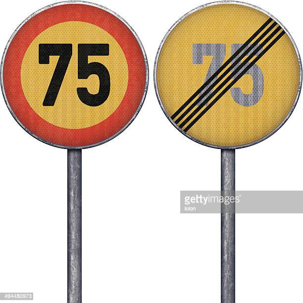 Two yellow and red maximum speed limit 75 road signs