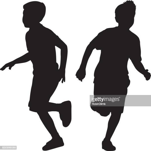 Two Young Boys Running Silhouettes