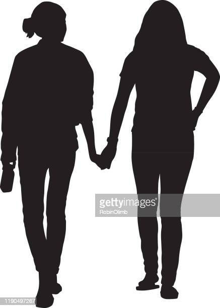 two young women walking holding hands - homosexual couple stock illustrations