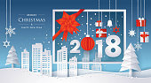 Typography 2018 with Gift box and ribbon, City in winter season