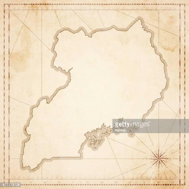 uganda map in retro vintage style - old textured paper - uganda stock illustrations, clip art, cartoons, & icons