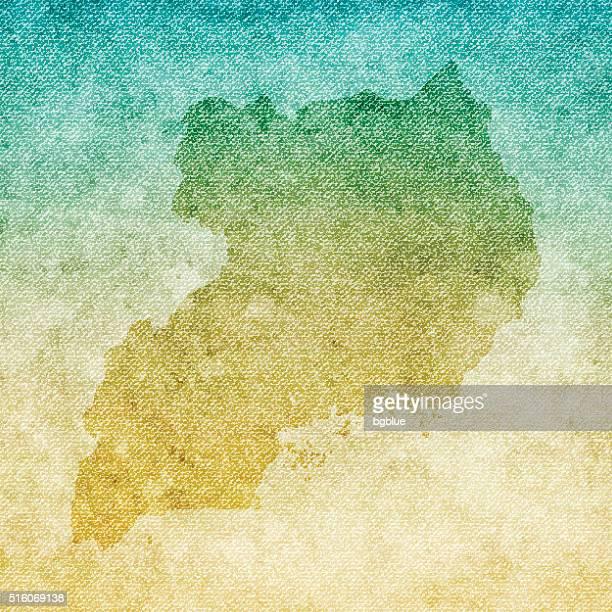 uganda map on grunge canvas background - uganda stock illustrations, clip art, cartoons, & icons