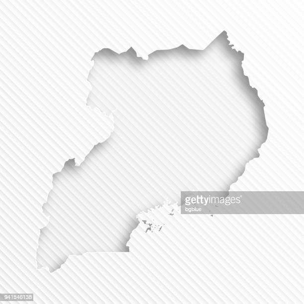 uganda map with paper cut on abstract white background - uganda stock illustrations, clip art, cartoons, & icons