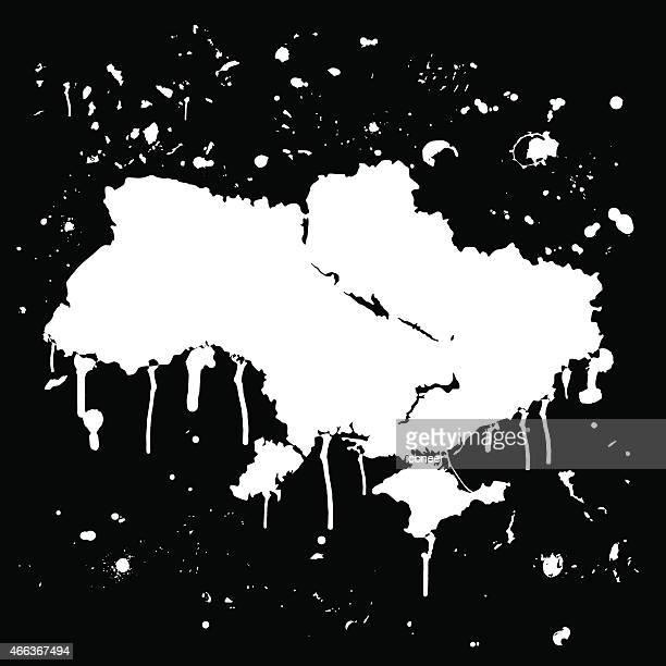 Ukraine map graffiti white splats on black wall