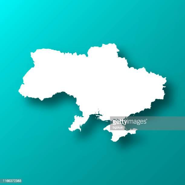 ukraine-karte auf blau-grünem hintergrund mit schatten - ukraine stock-grafiken, -clipart, -cartoons und -symbole