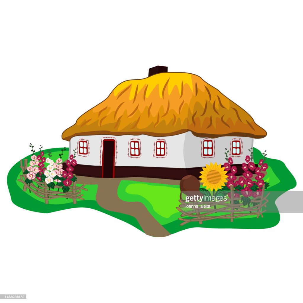 Ukrainian traditional house with white walls, thatched roof, flower garden and wicker fence
