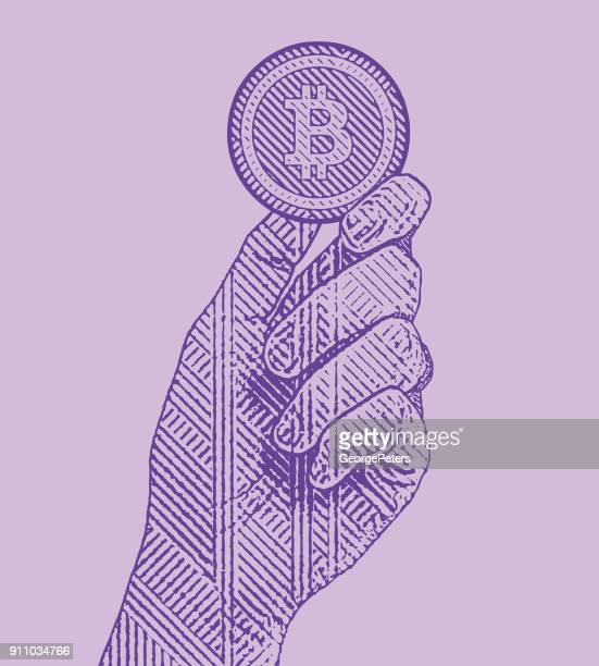 ultra violet engraving illustration of a hand holding a bitcoin - cryptocurrency stock illustrations