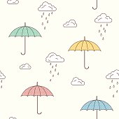 Umbrellas and rainy clouds background