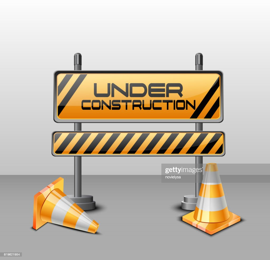 Under construction barrier with road cones