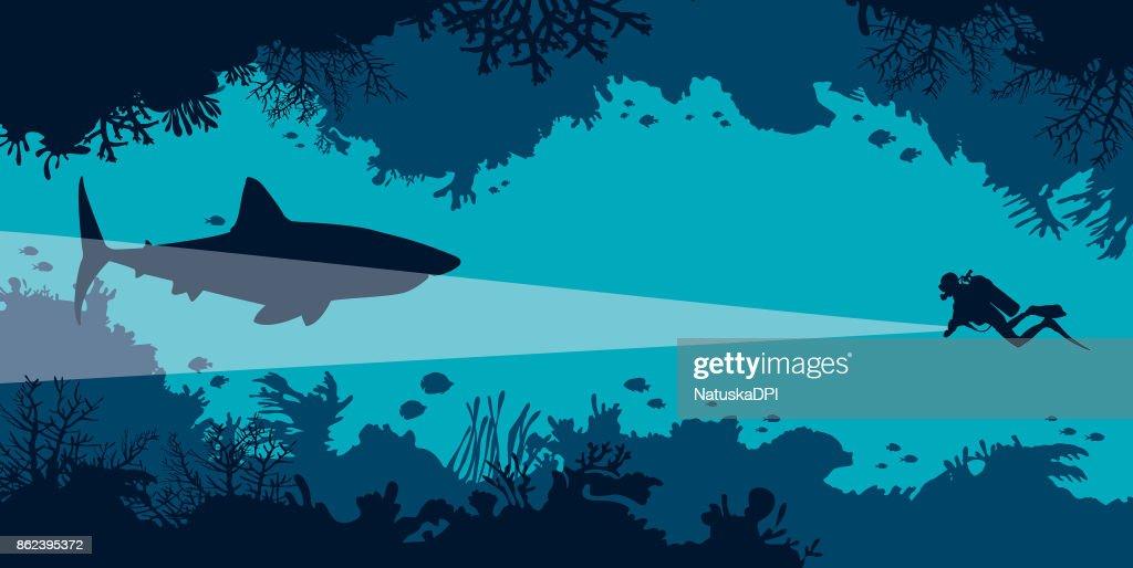 Underwater cave, scuba diver, shark, coral, fish, sea.