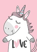 """unicorn illustration with hand lettering text """"love""""."""