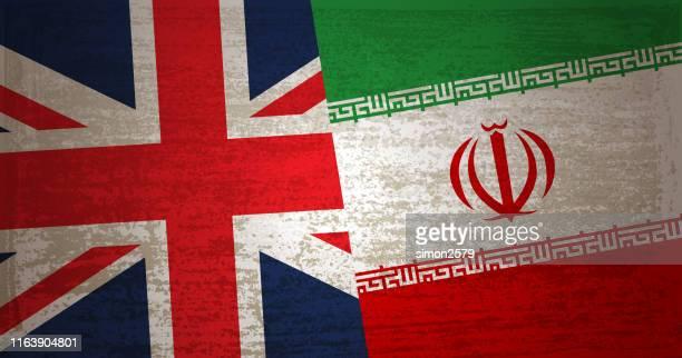 vereinigtes königreich und iran hintergrund mit grunge texturiert - iran stock-grafiken, -clipart, -cartoons und -symbole