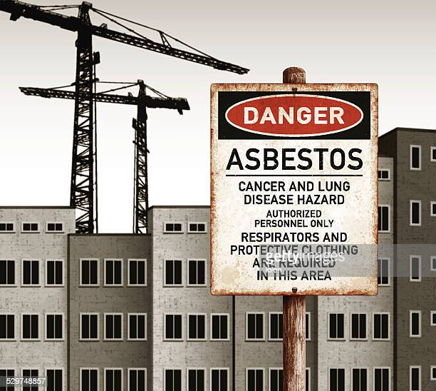 urban landscape with empty buildings and danger asbestos placard - asbestos stock illustrations, clip art, cartoons, & icons