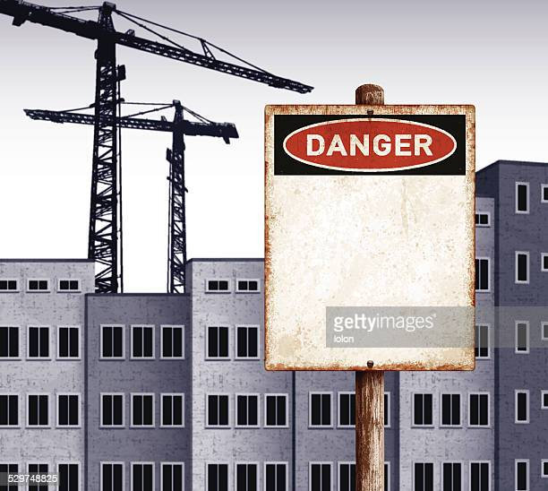 urban landscape with empty buildings and danger placard