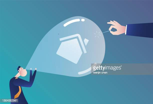 using a needle to pierce the real estate balloon blown by the businessman, the bubble economy - mortgage stock illustrations