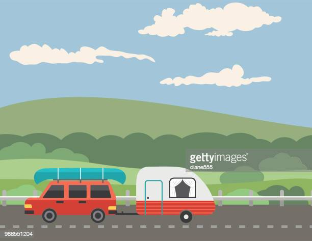 vacationer driving on a road through the mountains - country road stock illustrations