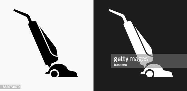 vacuum icon on black and white vector backgrounds - vacuum cleaner stock illustrations, clip art, cartoons, & icons