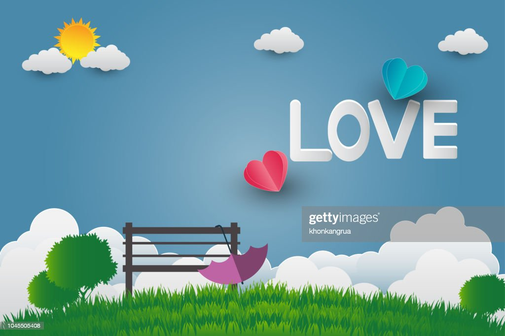 Valentine card day, umbrella with chair in public park bright sky With the letter love