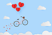 Valentine day , balloon heart hang bicycle float on the sky over clouds with sprinkle heart . paper art style. vector illustration