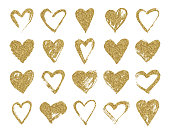 Valentine day hand drawn gold glitter doodle hearts.