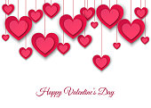 Valentines day  background with hanging  pink paper hearts.