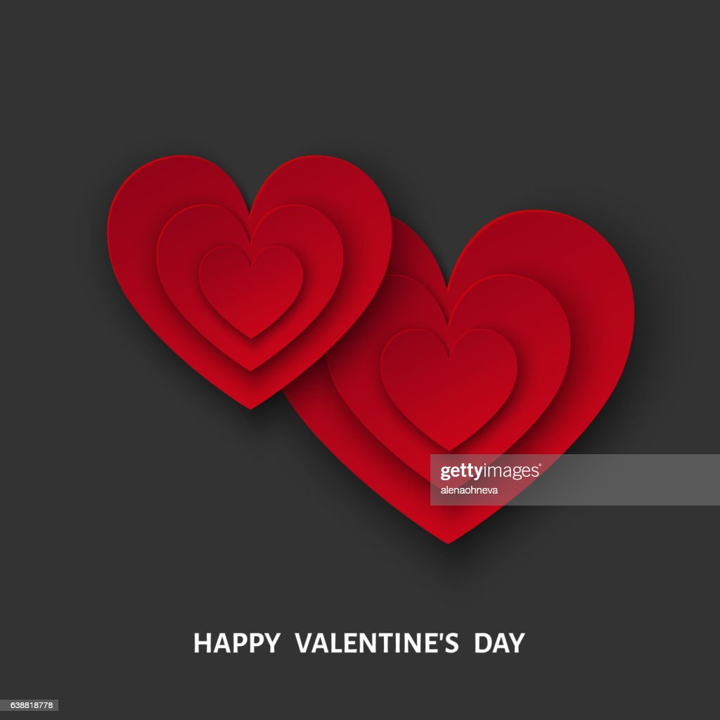 Valentines day black background with red  cut paper hearts.