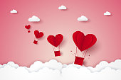 Valentines day , Illustration of love , red heart hot air balloons flying on sky , paper art style