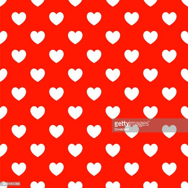 Valentine's Day polka dot seamless - White hearts on red background