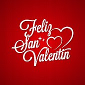 "Valentines day vintage lettering. ""Feliz San Valentin"" spanish text on red background"