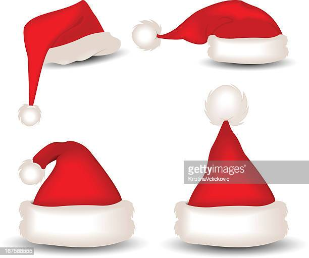 A variety of red and white Santa hats
