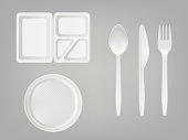 Vector 3d realistic disposable plastic lunch box, plate, spoon, fork, knife. Picnic tableware set on gray background.
