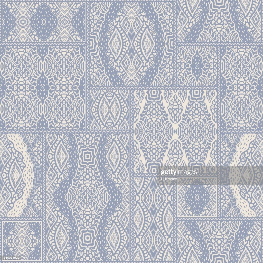Vector abstract seamless patchwork pattern from light blue and beige ethnic ornaments. Wallpaper background. Exotic batik, fantasy ikat tracery, textile print design, wrapping paper, album cover